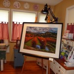 Painting in Dining room.   We use easels for display.